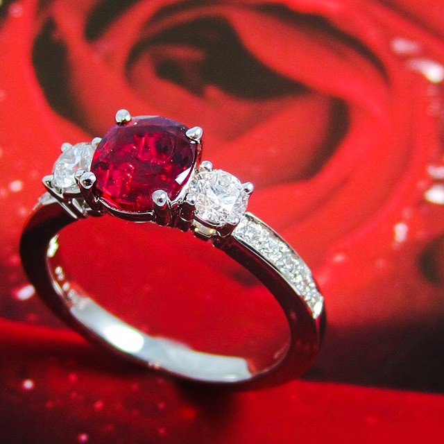 A stunning ruby and diamond ring by Suna Bros.
